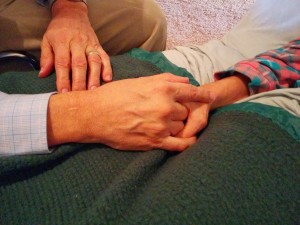 Dad's hand holding Mom